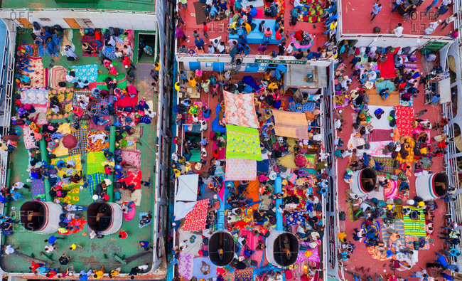 June 2, 2019: Aerial view of thousands of people who didn't get space inside are going home to celebrate the festival of Eid by roof top of launch in Sadarghat, Dhaka, Bangladesh.
