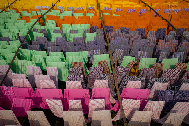 January 5, 2021: Aerial view of hundreds of sheets of multicolored cloth drying under sunlight in Narayanganj, Bangladesh.