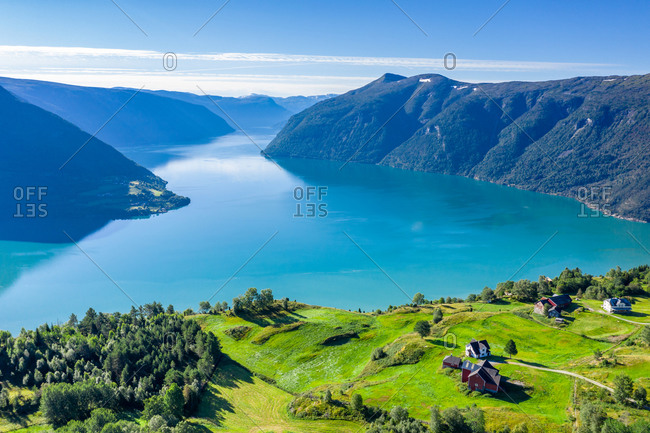 Aerial view of meadows and farms above the Lustrafjord, the inner Sognefjord, Norway