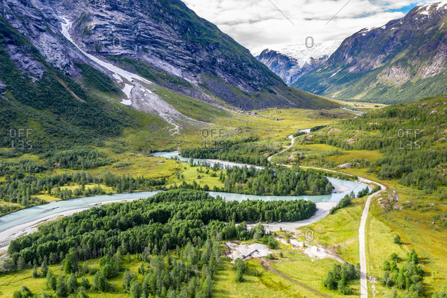 Aerial view of road from Hafslo to valley Langedalen where Jostedalsbre glacier stretches into the valley. Sognefjord region, Norway.