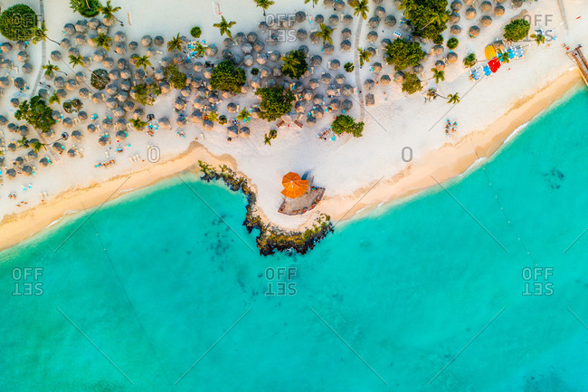 Aerial view of tourists enjoying the warm and crystal clear waters of the Caribbean at Bayahibe beach in San Rafael del Yuma, La Altagracia Province, Dominican Republic