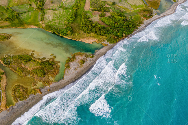 Aerial view of strong waves at Patos Beach at the mouth of the Rio Nizao during the golden hour, Nizao, Peravia, Dominican Republic