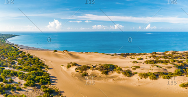 Panoramic aerial view of the dunes of Bani on a sunny day with the Caribbean Sea behind on a sunny day, Peravia, Dominican Republic