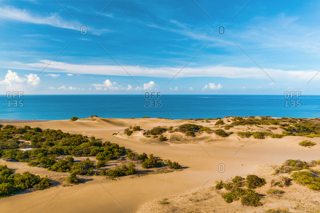Aerial view of the Bani dunes under a sky with many clouds, Peravia, Dominican Republic