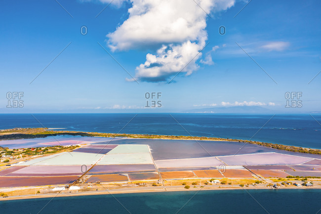 Aerial view of colorful roadside salt mines between the caribbean sea and bahia de las calderas, Bani, Dominican Republic