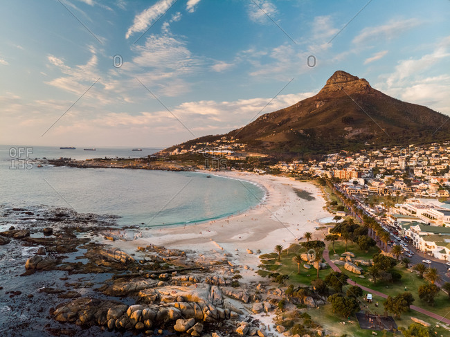 Aerial view of Camps Bay beach and Lions Head Mountain at sunset, Cape Town, South Africa
