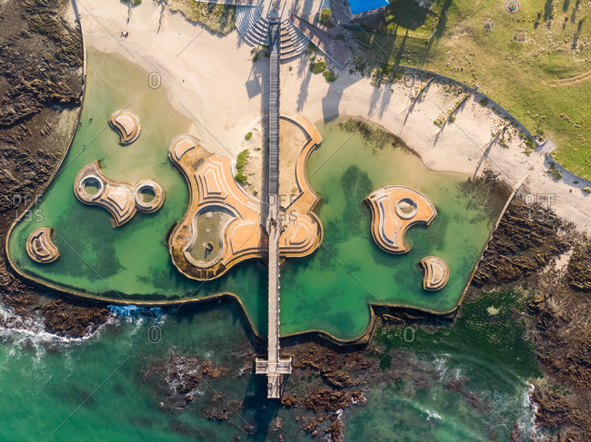 Aerial view of swimmers at Harmony Park tidal Pool, Cape Town, South Africa.