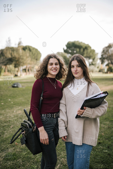 Portrait of two female friends students on college campus