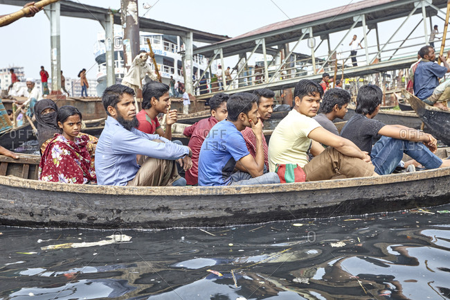 Dhaka, Bangladesh - April 27, 2013: Passengers sitting in a boat ready to departure from the Sadarghat