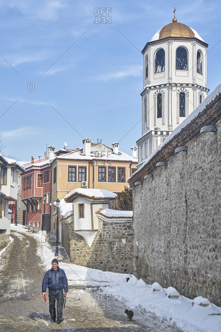 Plovdiv, Bulgaria - January 13, 2017: Man walking down a cobbled street in the historic old town of Plovdiv