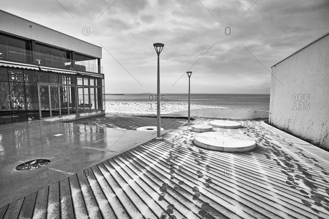 View of a beachfront deserted cafe on a cloudy, rainy day on the Black Sea in Varna, Bulgaria
