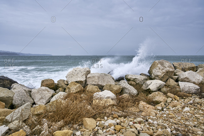 Big waves crashing onto a breakwater in Varna, Bulgaria