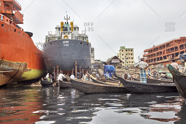 Dhaka, Bangladesh - April 27, 2013: Three big ships anchored at a shipyard on the Buriganga River
