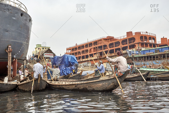 Dhaka, Bangladesh - April 27, 2013: Three big ships under reconstruction at a shipyard on the Buriganga River in Dhaka, Bangladesh