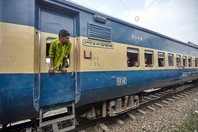Bangladesh - April 29, 2013: Passengers in a train carriage waiting for departure of the train somewhere in rural Bangladesh