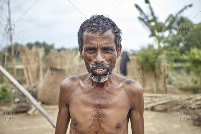 Bangladesh - April 30, 2013: Portrait of a thin shirtless man in rural Bangladesh