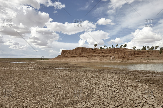 Dried land with cracked ground near a freshwater lake in Gobi desert, Mongolia