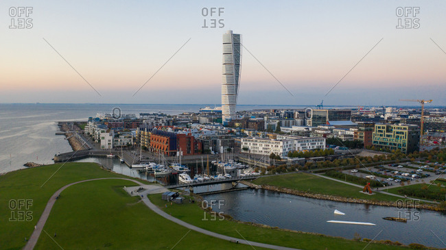 Malmo, Sweden - September 29, 2020: Scenic view of the city of Malmo with view of the Turning Torso viewed at sunset