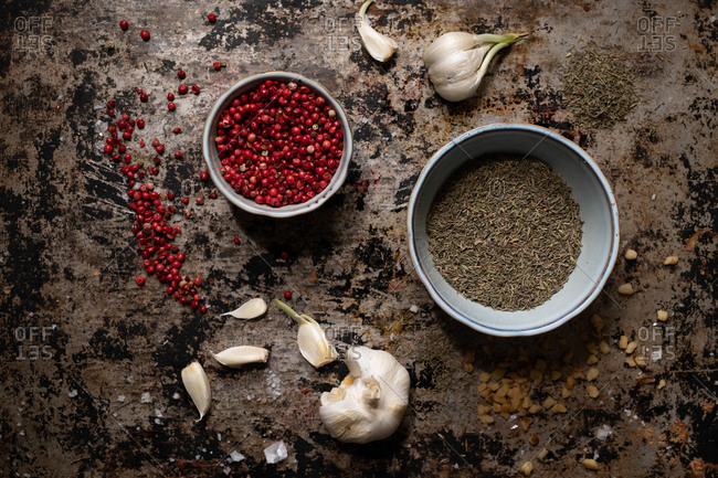 Dried herbs and ingredients on rustic surface