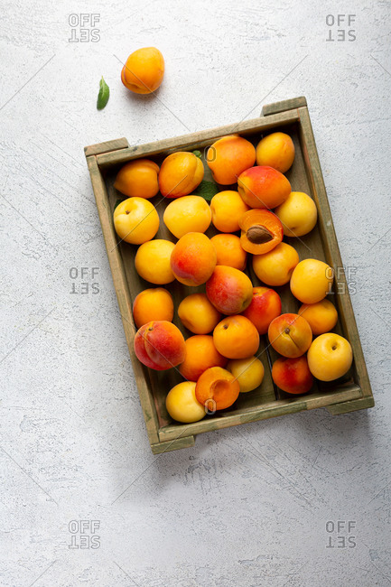 Overhead view of apricots in wooden crate