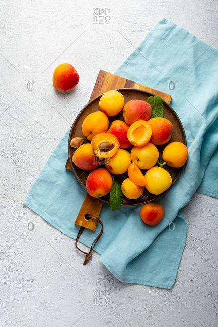 Overhead view of apricots on plate
