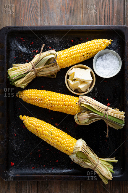 Overhead view of Corn cob with butter and salt