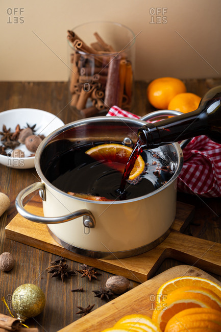 Close up of Pouring wine in pot for mulled wine
