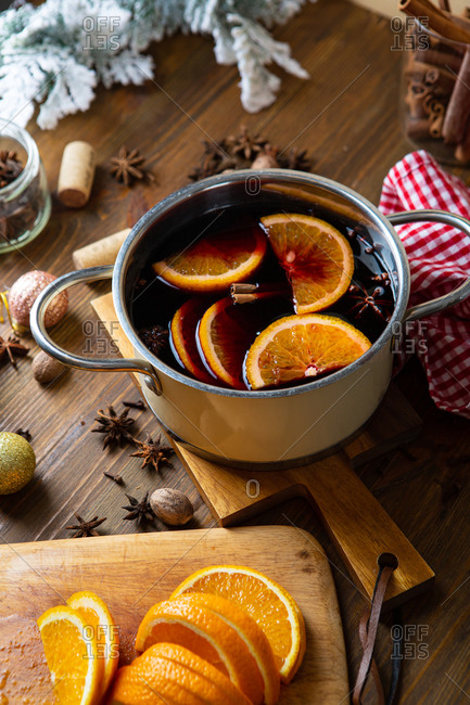 Pot of mulled wine on wooden table