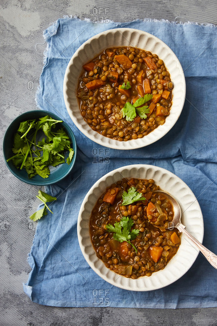Lentil and vegetable soup served on a table