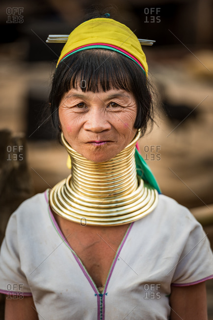 PADUANG PEOPLE,  HILL TRIBE, PAN PET VILLAGE, KAYAH STATE, MYANMAR - 24 January 2017: Portrait of local elder lady wearing big brass coils placed around the neck, appearing to lengthen it.