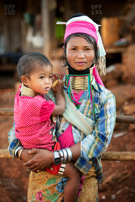PADUANG PEOPLE,  HILL TRIBE, PAN PET VILLAGE, KAYAH STATE, MYANMAR - 24 January 2017: Portrait of mother and baby, wearing brass coils placed around the neck, appearing to lengthen it.