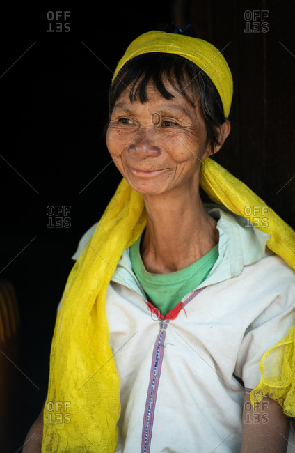 PADUANG PEOPLE,  HILL TRIBE, PAN PET VILLAGE, KAYAH STATE, MYANMAR - 28 January 2019: Portrait of long neck  lady not wearing brass coils placed around the neck, after many years.