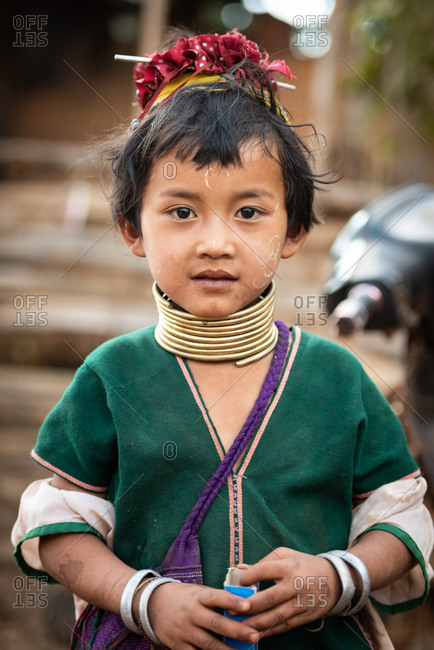 PADUANG PEOPLE,  HILL TRIBE, PAN PET VILLAGE, KAYAH STATE, MYANMAR - 24 January 2017: Portrait of young girl wearing brass coils placed around the neck, appearing to lengthen it.