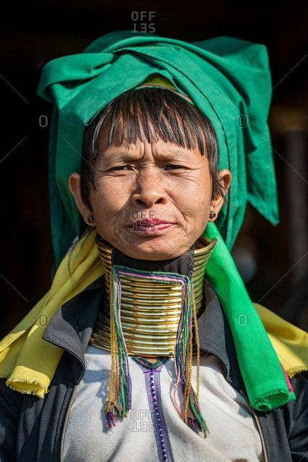PADUANG PEOPLE,  HILL TRIBE, PAN PET VILLAGE, KAYAH STATE, MYANMAR - 28 January 2019: Portrait of local lady wearing brass coils placed around the neck, appearing to lengthen it.