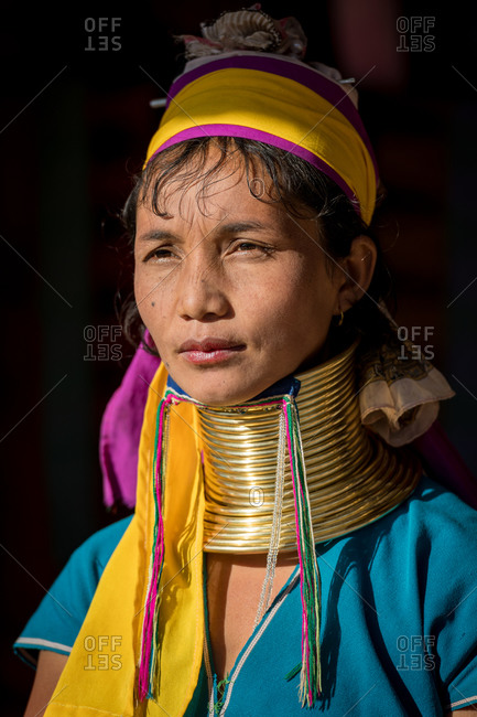 PADUANG PEOPLE,  HILL TRIBE, PAN PET VILLAGE, KAYAH STATE, MYANMAR - 20 January 2020: Portrait of local lady wearing brass coils placed around the neck, appearing to lengthen it.