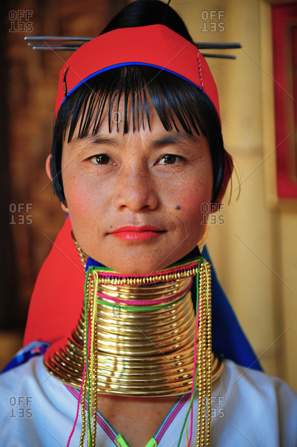 PADUANG PEOPLE,  HILL TRIBE, PAN PET VILLAGE, KAYAH STATE, MYANMAR - 16 April 2012: Portrait of local lady wearing brass coils placed around the neck, appearing to lengthen it.
