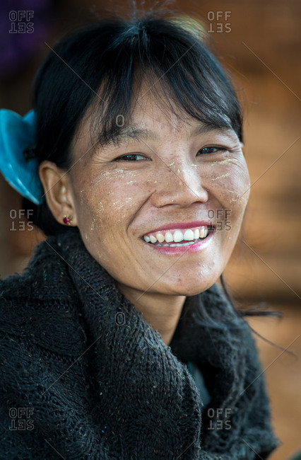 PADUANG PEOPLE,  HILL TRIBE, PAN PET VILLAGE, KAYAH STATE, MYANMAR - 28 January 2019: Portrait of Kayan lady not wearing brass coils placed around the neck, against tradition.
