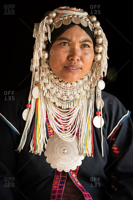 AKHA HILL TRIBE, HOKYIN VILLAGE, MYANMAR - 22 January 2019: Close up portrait of hill tribe women in traditional dress and decorated head dress and chin strap.