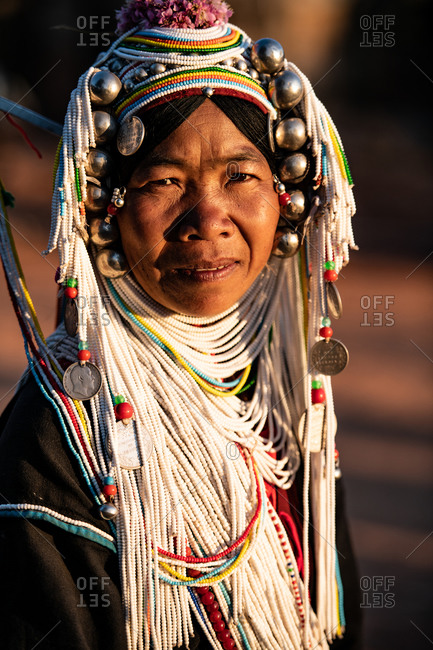 AKHA HILL TRIBE, HOKYIN VILLAGE, MYANMAR - 22 January 2019: Close up portrait of elderly hill tribe women in traditional dress and decorated head dress.