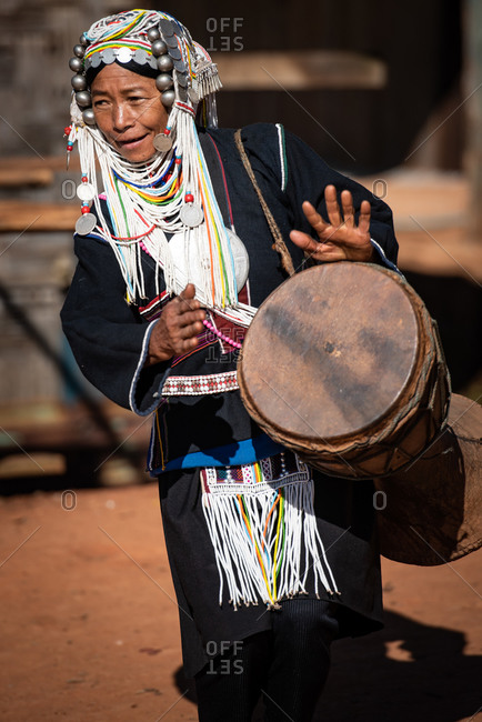 AKHA HILL TRIBE, HOKYIN VILLAGE, MYANMAR - 18 January 2017: Women in traditional dress playing musical instruments, singing and dancing in their village.