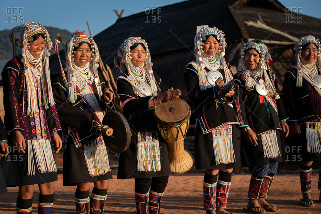 AKHA HILL TRIBE, HOKYIN VILLAGE, MYANMAR - 22 January 2019: Women in traditional dress playing musical instruments, singing and dancing in their village.