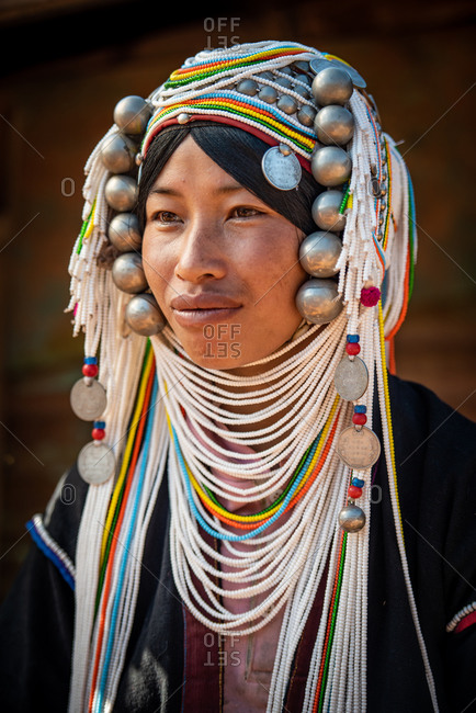 AKHA HILL TRIBE, HOKYIN VILLAGE, MYANMAR - 18 January 2017: Close up portrait of young hill tribe women in traditional dress and decorated head dress.