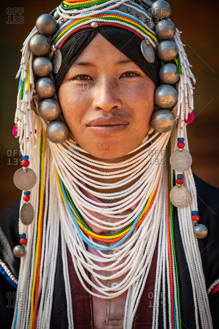 AKHA HILL TRIBE, HOKYIN VILLAGE, MYANMAR - 18 January 2017: Close up portrait of hill tribe women in traditional dress and decorated head dress.