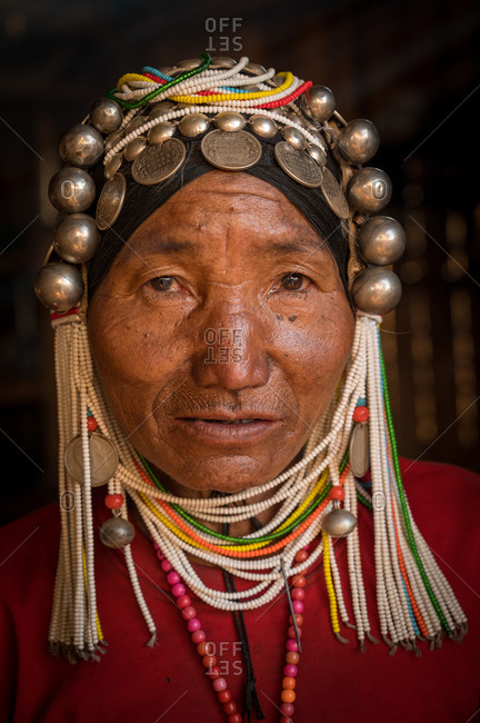 AKHA HILL TRIBE, HOKYIN VILLAGE, MYANMAR - 22 January 2019: Close up portrait of hill tribe women in traditional dress and decorated head dress.