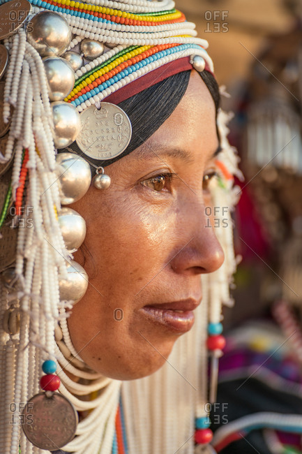 AKHA HILL TRIBE, HOKYIN VILLAGE, MYANMAR - 19 November 2019: Close-up of ethnic minority woman head dress with Indian coin.