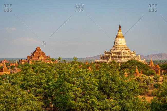 Shwesandaw Pagoda and Dhammayan Gyi temple in evening light.