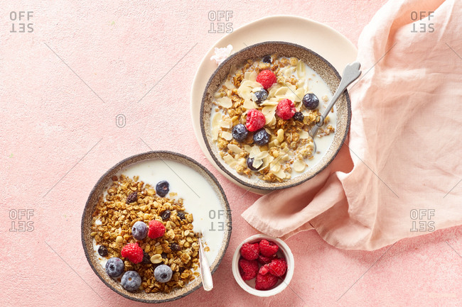 Top view of tasty breakfast with granola, berries and milk
