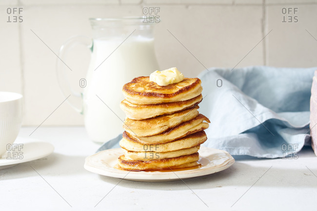 Fluffy breakfast pancakes with maple syrup and berries