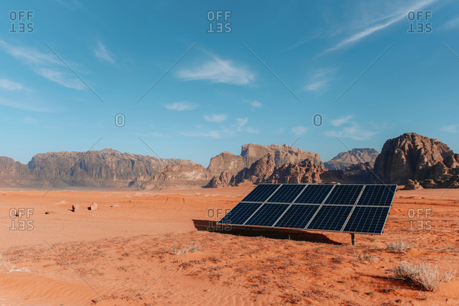 Panel of modern solar battery installed on dry ground in Wadi Rum valley on sunny day