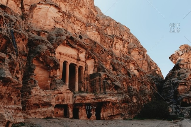 Low angle of spectacular historic temple The Treasury carved in rough rock in Petra in Jordan